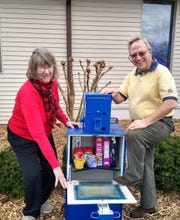 Bull Shoals' first blessing box was recently was installed at Christ by the Lake Lutheran Church at the corner of Marilyn Avenue and C.S. Woods Boulevard. Displaying items in the Blessing Box are (from left) Linda Masters, Church Council vice president; and Tim Koenig, Church Council president. The box contains non-perishable food and personal hygiene items and is available 24 hours a day to those who need help.