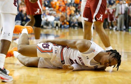 Auburn forward Isaac Okoro (23) grabs his hamstring after suffering an injury against Alabama on Feb. 12, 2020.