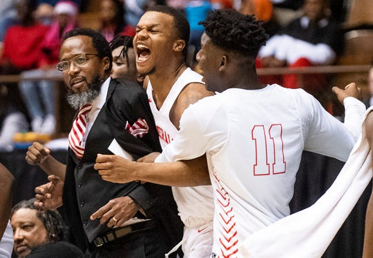 Lee coach Bryant Johnson, Jamari Smith (1) and Nicholas Barnes (11) celebrate a late dunk against Central-Phenix City in AHSAA Regional action at Garrett Coliseum in Montgomery, Ala., on Thursday February 13, 2020.
