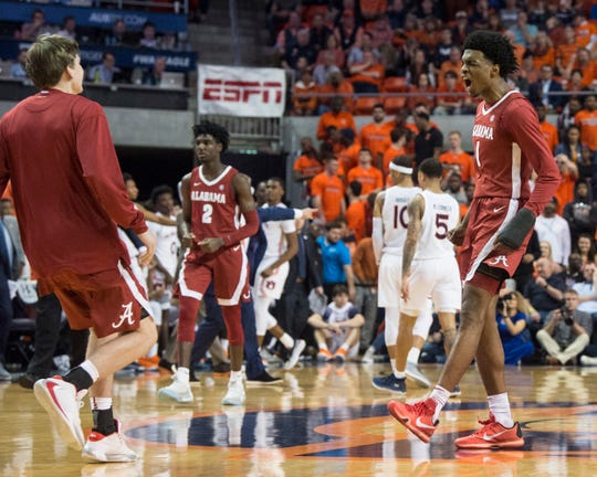 Alabama's Herbert Jones (1) celebrates with his team at the end of regulation at Auburn Arena in Auburn, Ala., on Wednesday, Feb. 12, 2020. Auburn defeated Alabama 95-91.