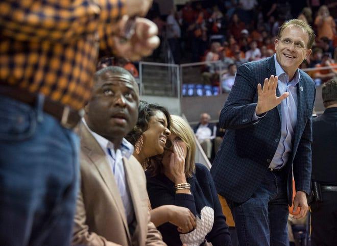 Auburn football coach Gus Malzahn joins the crowd at the Auburn vs. Alabama basketball game at Auburn Arena in Auburn, Ala., on Wednesday, Feb. 12, 2020.