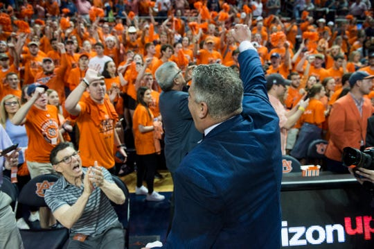 Auburn head coach Bruce Pearl greets the crowd after the game at Auburn Arena in Auburn, Ala., on Wednesday, Feb. 12, 2020. Auburn defeated Alabama 95-91.