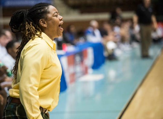 Jeff Davis coach LaKenya Knight talks with her team from the sideline during the Class 7A Southeast Regional at Garrett Coliseum in Montgomery, Ala., on Thursday, Feb. 13, 2020.