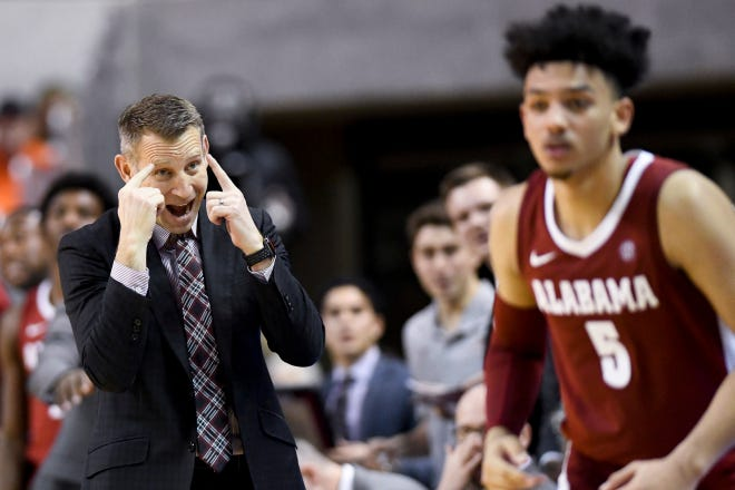 Alabama head coach Nate Oats talks to Alabama guard Jaden Shackelford (5) during the second half of an NCAA college basketball game against Auburn, Wednesday, Feb.12, 2020, in Auburn, Ala. (AP Photo/Julie Bennett)