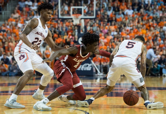 Auburn guard J'Von McCormick (5) steals the ball from Alabama's Kira Lewis Jr. (2) in the game securing possession at Auburn Arena in Auburn, Ala., on Wednesday, Feb. 12, 2020. Auburn defeated Alabama 95-91.