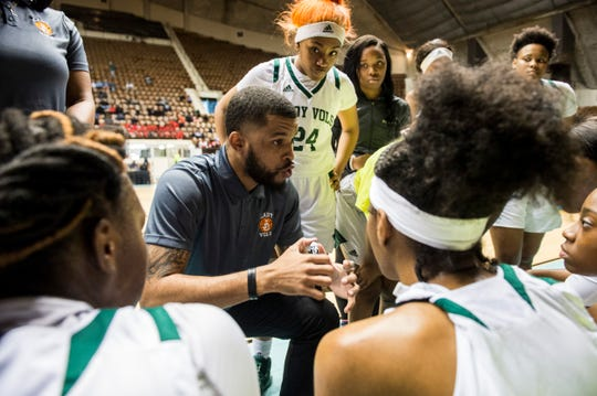 Jeff Davis coach Charvez Davis talks with his team during a break in the action during the Class 7A Southeast Regional at Garrett Coliseum in Montgomery, Ala., on Thursday, Feb. 13, 2020.
