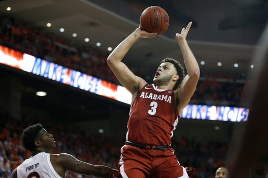 Feb 12, 2020; Auburn, Alabama, USA; Alabama Crimson Tide forward Alex Reese (3) shoots against the Auburn Tigers during the first half at Auburn Arena. Mandatory Credit: John Reed-USA TODAY Sports