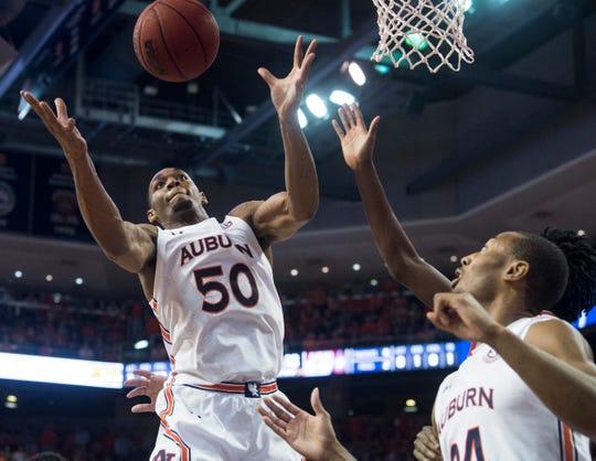 Auburn center Austin Wiley (50) grabs a rebound at Auburn Arena in Auburn, Ala., on Wednesday, Feb. 12, 2020. Auburn leads Alabama 44-41 at halftime.