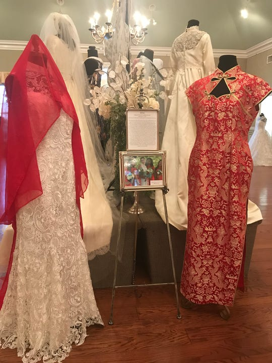 """Taffy Xu's traditional Chinese and American wedding dresses are on display at the """"Wedding Dresses Through the Decades"""" exhibits on display a Oaklands Mansion."""