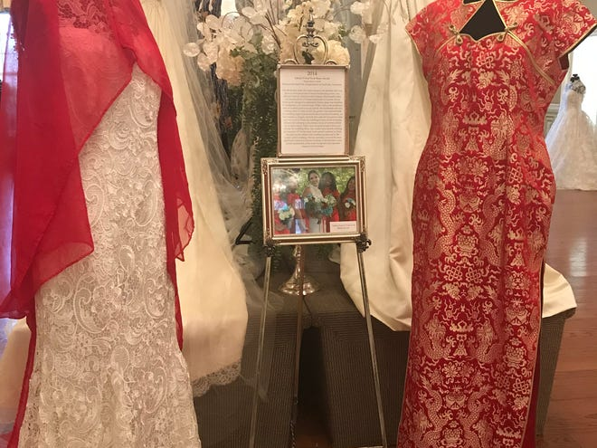 "Taffy Xu's traditional Chinese and American wedding dresses are on display at the ""Wedding Dresses Through the Decades"" exhibits on display a Oaklands Mansion."
