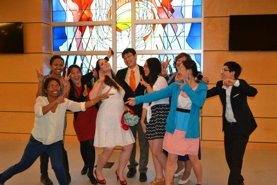 Shane and Taffy Xu pose with friends during their first wedding ceremony in a chapel at David Lipscomb University in Nashville.