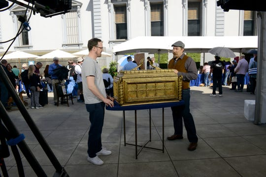 """James Supp, right, appraises a 1981 """"Raiders of the Lost Ark"""" prototype at Crocker Art Museum, in Sacramento, California, in an """"Antiques Roadshow"""" episode airing Feb. 24."""