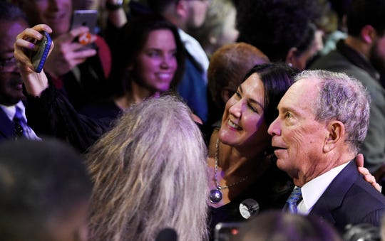 Democratic presidential candidate Mike Bloomberg poses for a photo with a supporter at his 2020 Early Vote Rally at Rocketown Wednesday, Feb. 12, 2020 in Nashville, Tenn.