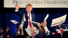 Republican presidential candidate Donald Trump waves before he speaks at an event for the National Federation of Republican Assemblies at Rocketown in Nashville Aug. 29, 2015.