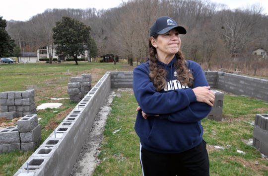 Elixa Beaumont and her husband put down a deposit, got permits and spent even more building a foundation on their Franklin property for a cabin to house her elderly parents. Months later, Beaumont is among the scores of customers abandoned by Riverwood Cabins, which filed for bankruptcy this week.