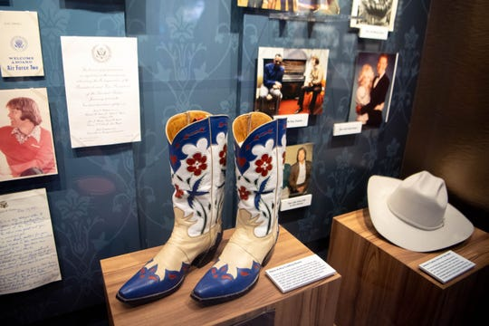 Glen Campbell's Gene Autry Cowboy Boots are displayed at Glen Campbell Museum and Rhinestone Stage Wednesday, Feb. 12, 2020, in Nashville, Tenn.