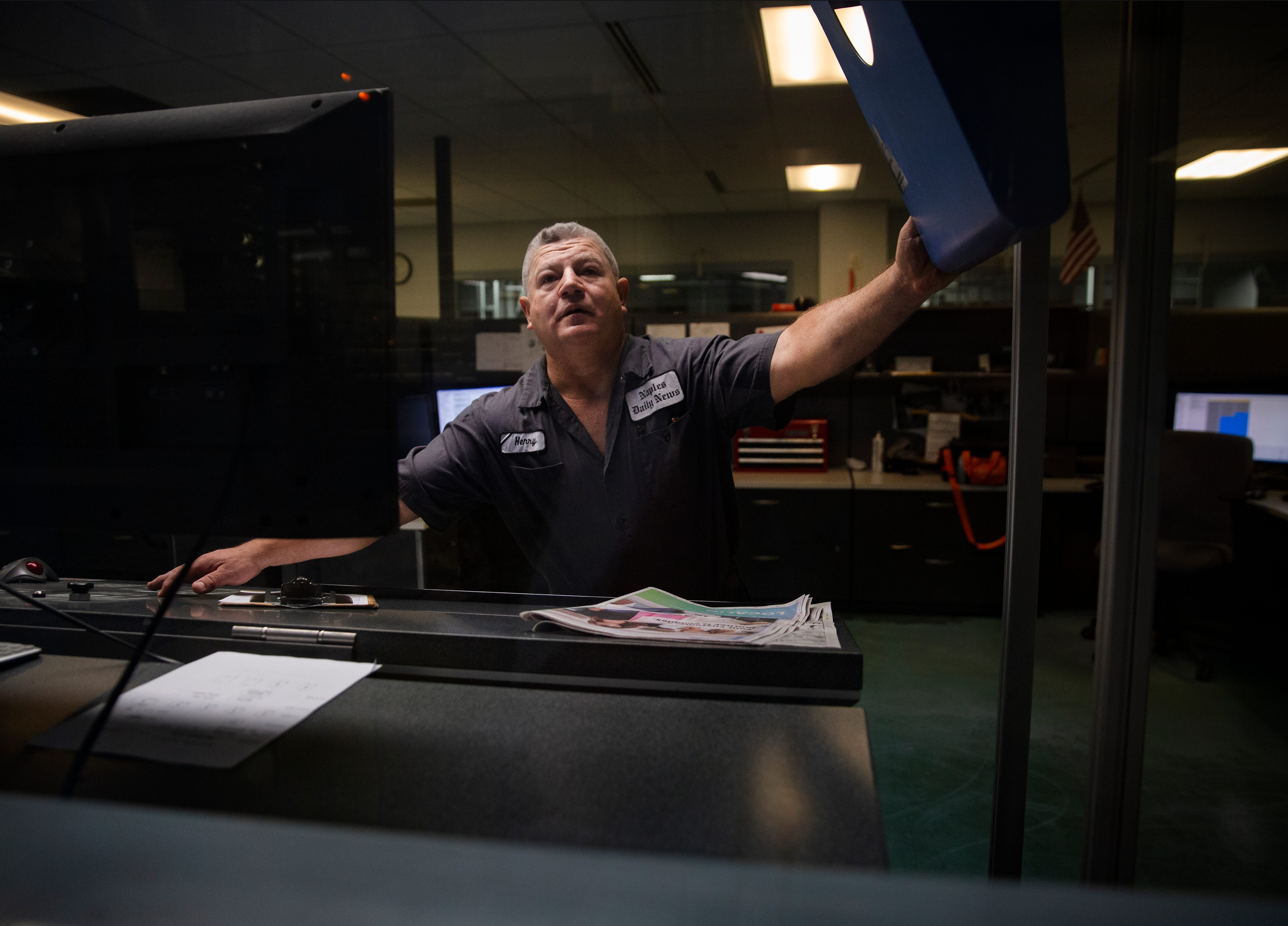 Press operator Henry Reyes monitors computers during a press run on Wednesday, Feb. 12, 2020, at the Naples Daily News.