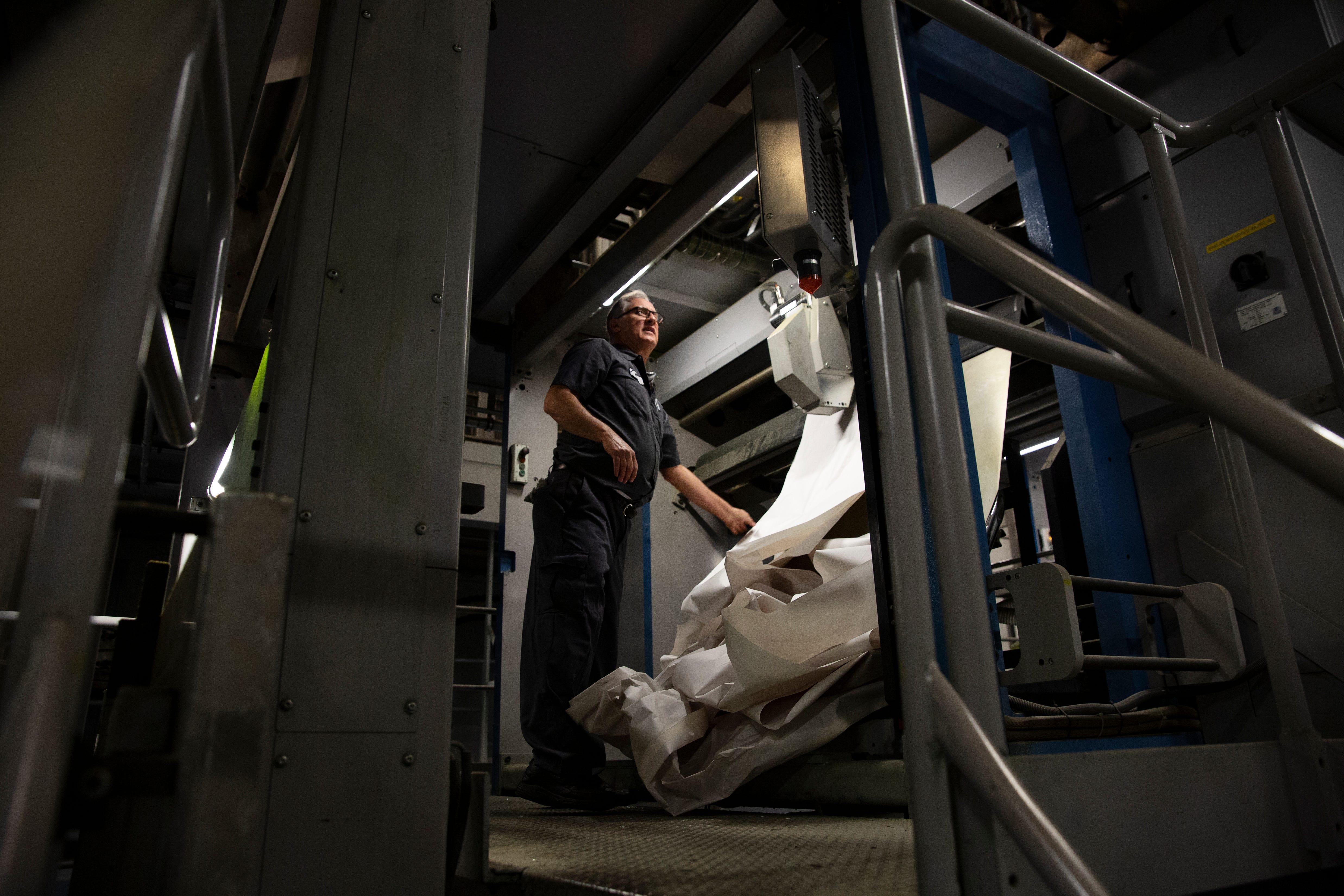 Press operator Mick Eddins prepares the presses for a run, Wednesday, Feb. 12, 2020, at the Naples Daily News.