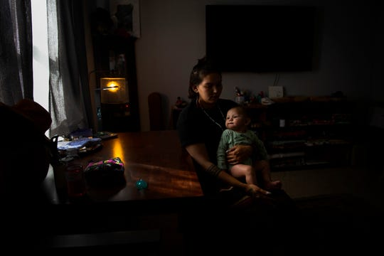 Marissa Osceola sits at her desk with her son, 5-month old Ryder Osceola-Haltof during an interview, Tuesday, Feb. 11, 2020, at her home in Golden Gate Estates. Marissa says that she will pass on the stories and traditions of their Seminole heritage on to her son.