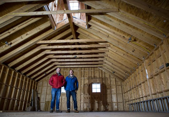 """Chris Crader and Trent Beers stand in the upper level of a barn they are remodeling to be """"Seek-No-Further Cidery"""" in downtown Granville. The cidery is expected to open in April. The pair received council approval for their project last fall and overcame an appeals process initiated by a nearby business on their way toward opening."""