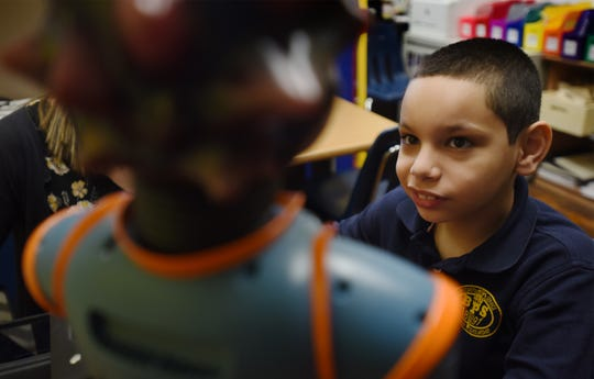 Gabby Velez (age 9), takes a close look at Milo during the Autism Programs at School no.7 in Belleville on 02/12/20. Mitsu Yasukawa/Northjersey.com