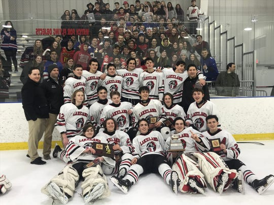 Lakeland hockey celebrates their second straight Passaic County tournament title and fifth title in six years