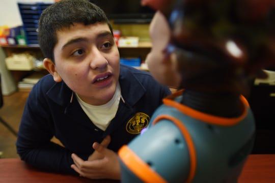 Tomas Alvarez (age 12), takes a close look at Milo during the Autism Programs at School no.7 in Belleville on 02/12/20. Mitsu Yasukawa/Northjersey.com