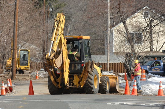 Workers are seen working along Furnace Avenue in Wanaque, the road is set to be repaved and given a new underground water line in 2020.