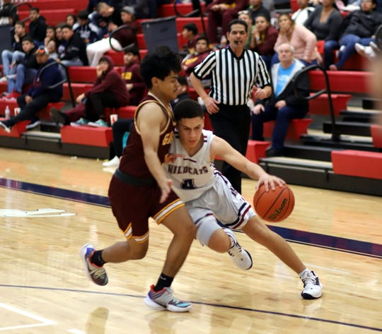 Junior Wildcat Jonathan Caballero (4) drove baseline for two of his team-high 8 points in a 48-31 loss to the Gadsden High Panthers on Wednesday.