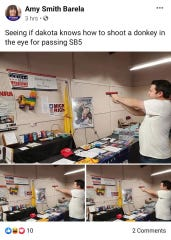A Facebook post by Otero County GOP chairwoman Amy Smith  Barela includes photos of a man aiming a weapon described as a laser training gun used for target practice at a rainbow-colored donkey piñata at the party's information table at a gun show in Alamogordo, New Mexico on February 8 or 9, 2020.
