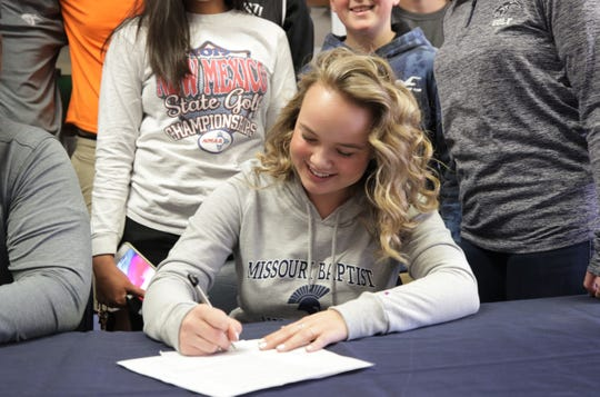 Piedra Vista's Maclovia Stubblefield signs her national letter of intent on Thursday to continue her golf career at NAIA's Missouri Baptist University.