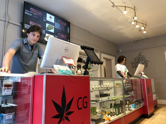 In this March 6, 2019 file photo, Korbin Osborn, left, works as a cannabis adviser at a medical marijuana dispensary in Santa Fe. Legalization for the first time enjoys the full throttled support of second-year Democratic Gov. Michelle Lujan Grisham, but the latest legislation stalled this week in a legislative committee.