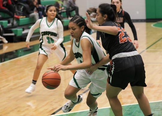Farmington's Davina Begay drives toward the basket against Eldorado's Maria Barela during Wednesday's District 2-5A girls basketball game at Scorpion Arena in Farmington.