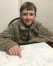 Logan Gray studies geography as he prepares for the 2020 National Memory Competition.