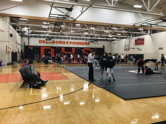 The Wayne Memorial wrestling team competes in the district semifinals at Dearborn on Feb. 12.