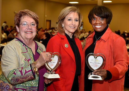 Camille Fontenot, left, and Lavonya Malveaux, right, were presented with the Women with Heart award. Pictured with Fontenot and Malveaux is Louisiana first lady Donna Edwards, who was the keynote speaker for the eighth annual Women With Heart event sponsored by the St. Landry and Evangeline United Way.