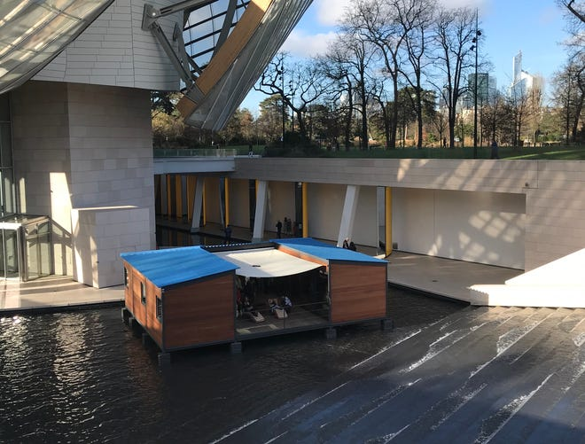 Le Maison au bord de l'eau was designed by Charlotte Perriand in 1934 and constructed as a prototype in 2013, seen here on display at the Fondation Louis Vuitton museum in Paris.