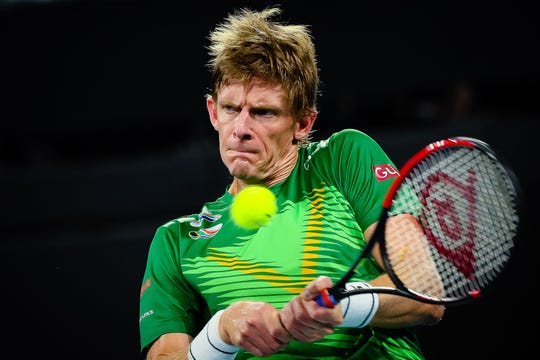 Kevin Anderson of South Africa hits a return to Benoit Paire of France in Brisbane on January 8, 2020.
