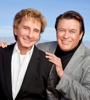 Barry Manilow and husband Garry Kief have raised and donated more than $2.5 million to charities and schools in the Coachella Valley.