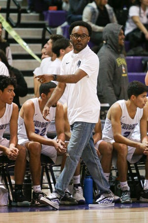 Head coach Ryan Towner on the sideline communicating the next play with this team. The Shadow Hills varsity basketball team won Wednesday's home playoff game against Yucaipa by a score of 84-67.