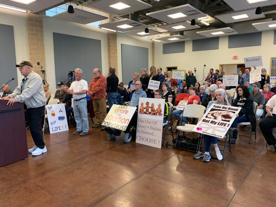 """Dozens of pro-abortion rights and anti-abortion activists attended the Santa Rosa County Commission meeting Thursday to voice their opinions on a controversial """"pro-life sanctuary"""" resolution that the board was considering adopting. The board ultimately declined to take action on the resolution and will leave it up to voters to decide in November."""