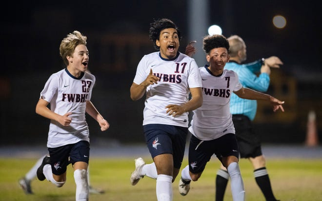 The Vikings celebrate taking a 1-0 lead in overtime during the first-round Class 5A state tournament boys soccer game between Fort Walton Beach and Washington at Booker T. Washington in Pensacola on Wednesday, Feb. 12, 2020.