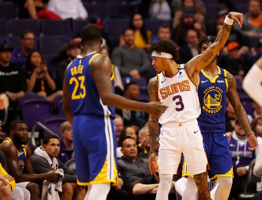 Phoenix Suns forward Kelly Oubre Jr. (3) looks back towards the Golden State Warriors bench after hitting a three-point field goal during the fourth quarter at Talking Stick Resort Arena February 12, 2019.