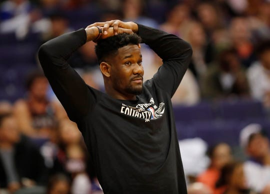 Phoenix Suns center Deandre Ayton (22) watches his team play against the Golden State Warriors during the fourth quarter at Talking Stick Resort Arena February 12, 2019. Ayton is nursing an injury.