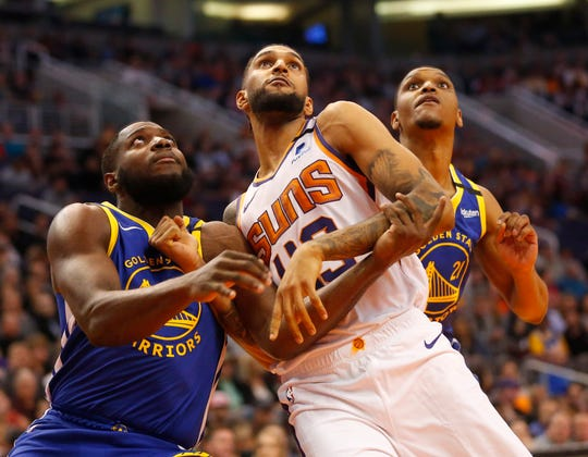 Phoenix Suns forward Jonah Bolden (43) looks to rebound against Golden State Warriors forward Eric Paschall (7) and guard Jeremy Pargo (20)  during the first quarter at Talking Stick Resort Arena February 12, 2019.