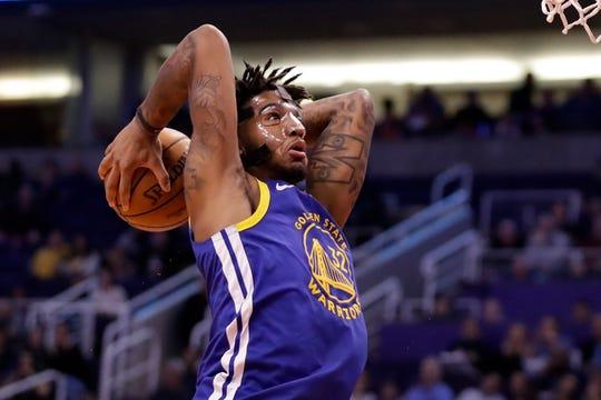 Golden State Warriors forward Marquese Chriss (32) dunks against the Phoenix Suns during the first half of an NBA basketball game, Wednesday, Feb. 12, 2020, in Phoenix. (AP Photo/Matt York)