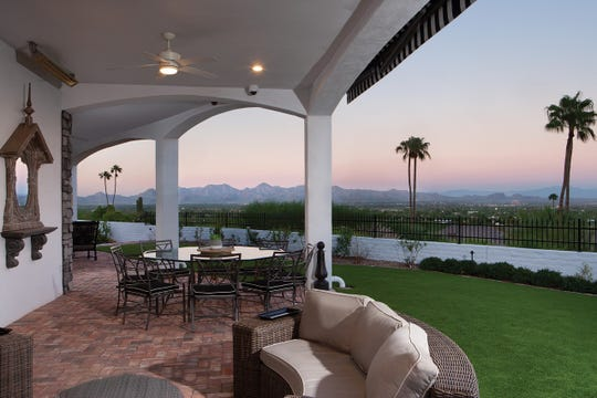 The $4.06M estate, purchased by Mills and Loretta Brown, has a covered patio that offers mountain and city light views.