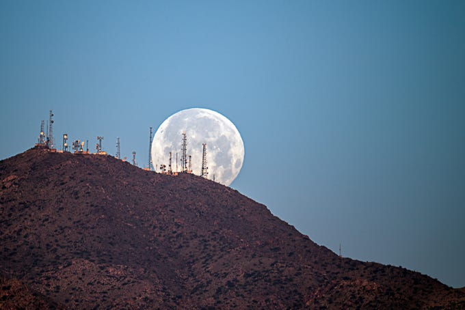 Snow Moon at  Barry Goldwater Peak at White Tank Mountains .
