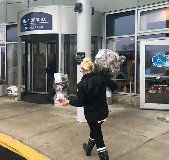 Royer's Flowers and Gifts delivery driver Aimee Klopp makes her way into WellSpan Good Samaritan Hospital with some Valentines flower arrangements. Royer's will sell between 20,000 and 25,000 flower arrangements this Valentine's Day.