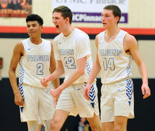 Cedar Crest's Amani Jones(2), Jason Eberhart (42) and Grant Allwein (14) head to the bench during a time-out after Jason Eberhart put Cedar Crest up 44-43 with just two minutes to play.